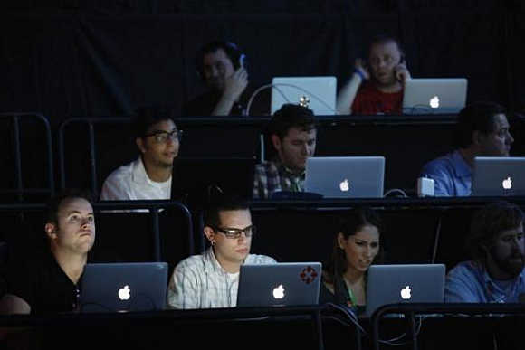 Writers use computers during the Sony news conference show on the eve of the opening of E3, the Electronic Entertainment Expo, in Los Angeles, California.