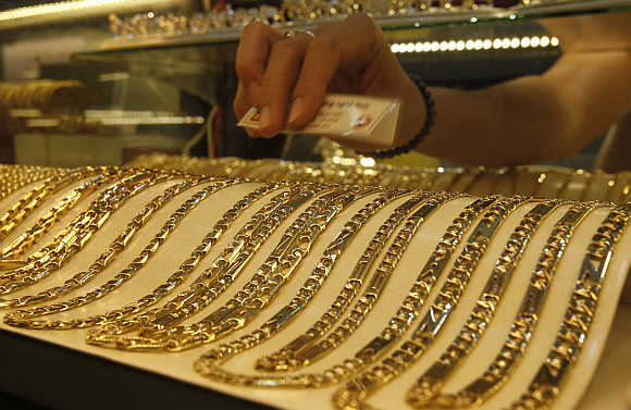 Gold chains are displayed for sale at a shop.