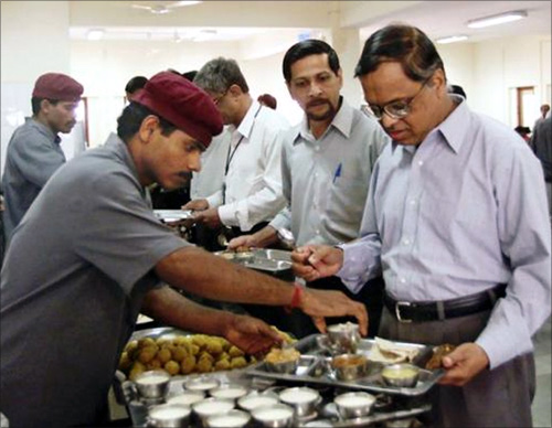 A file photo of Narayana Murthyin Infosys cafeteria during lunch time.