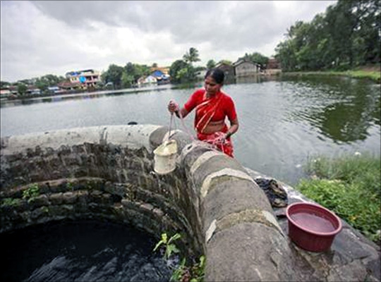 A woman fetches water from a well at Pargoan village, the proposed site of Navi Mumbai airport, about 45 km east of Mumbai.