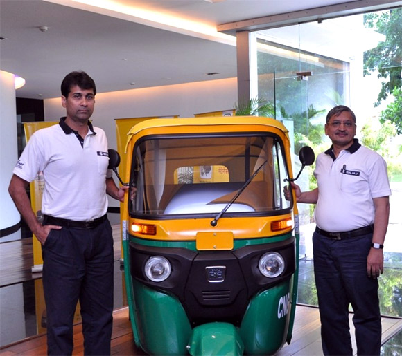 Rajiv Bajaj, MD and R C Maheshwari, President - CV Bajaj Auto with the newly launched RE - Compact.