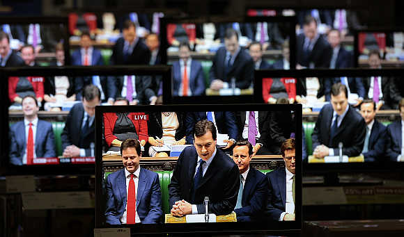 Britain's Chancellor of the Exchequer George Osborne is shown making his budget speech on television screens in an electrical store in Edinburgh, Scotland. A file photo.