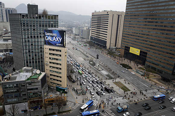 A Samsung outdoor advertisement sits atop an office building in Seoul, South Korea.