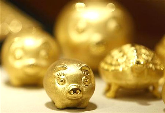 Gold pigs are displayed for customers at a jewellery shop at the Shinsegae department store in Seoul.