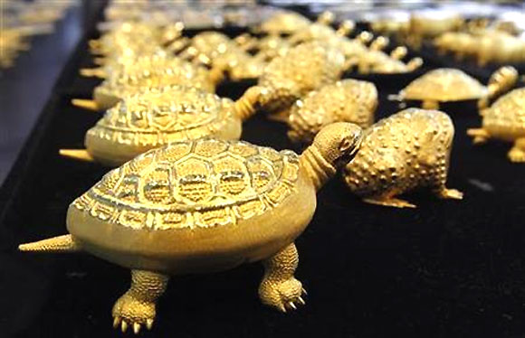 Gold turtles and toads are displayed at a jewellery shop in Seoul.