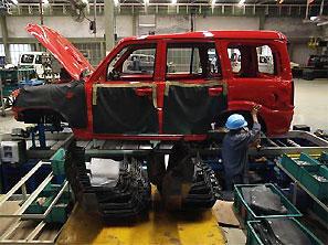A mechanic works at a Mahindra & Mahindra car factory in Nashik. Photograph: Adeel Halim/Reuters