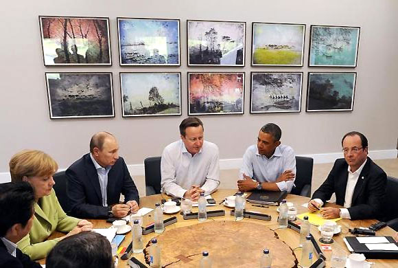 Britain's Prime Minister David Cameron sits with U.S. President Barack Obama, French President Francois Hollande, Russian President Vladimir Putin, German Chancellor Angela Merkel, and other G8 leaders, during the second Plenary Session of the G8 Summit, at Lough Erne, near Enniskillen, in Northern Ireland, June 18, 2013.
