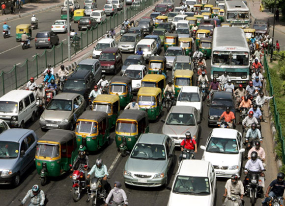 Traffic moves at a slow pace in New Delhi.
