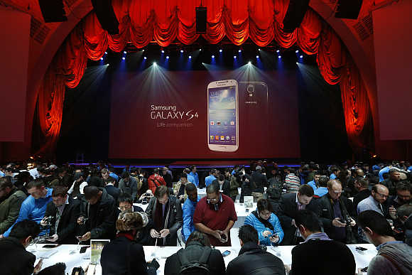 Event goers use Samsung Galaxy S4 smartphone at the Radio City Music Hall in New York.