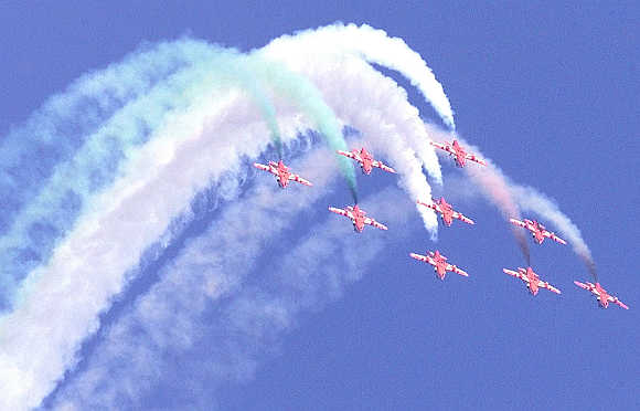 Indian Air Force pilots perform during an air show in Baroda.