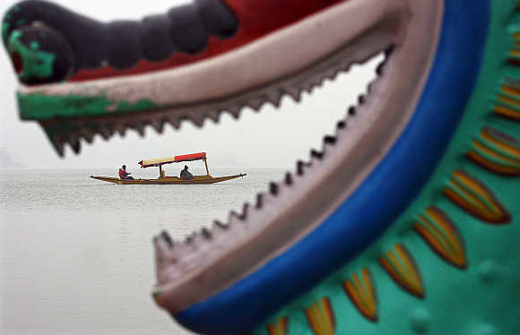 Tourists take a boat ride at Sukhana Lake in Chandigarh.