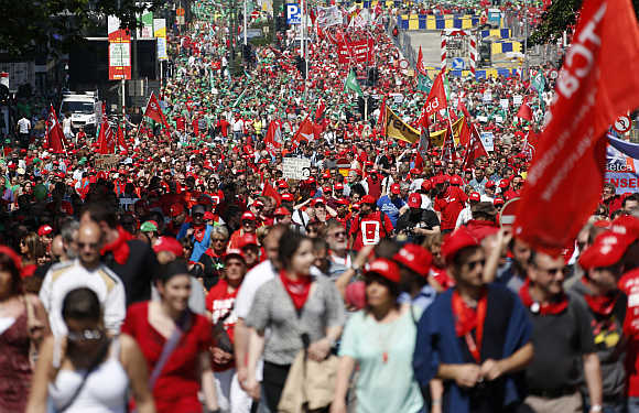 Tens of thousands of public sector workers, employees and trade union members protest against austerity measures during a march through central Brussels in Belgium.