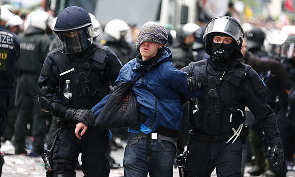 German police detain a protester during an anti-capitalism demonstration in Frankfurt.