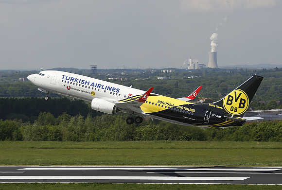 A plane carrying soccer players of Borussia Dortmund, and painted in the clubs colours, takes-off from Dortmund's airport in Germany, on its way to London.