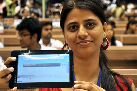 Students display Aakash tablet in New Delhi.