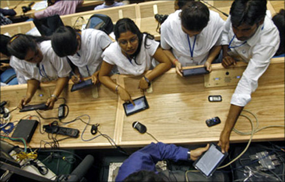 Students with Aakash Tablet.