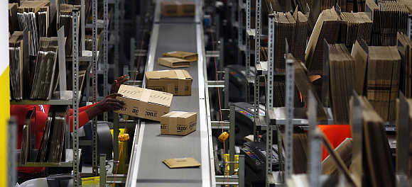 A worker packs boxes at Amazon's logistics centre in Graben near Augsburg, Germany.