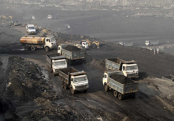 Trucks move in the Mahanadi coal fields, near Talcher town, in Orissa.