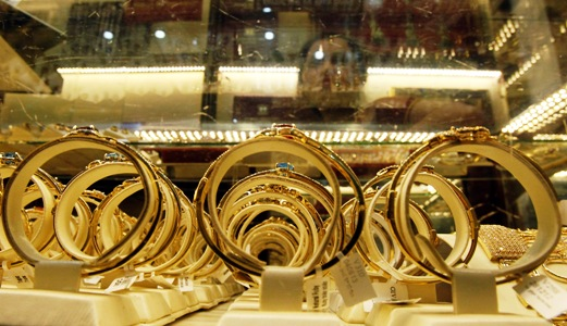 Gold products on sale are displayed at a shop in Hanoi.
