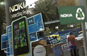 A man is reflected on the glass door of a Nokia showroom in New Delhi. Photograph: Mansi Thapliyal/Reuters