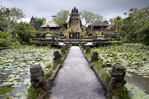 Pura Taman Saraswati temple, devoted to Dewi Saraswati, the goddess of learning, literature and the arts, is framed in lotus ponds in central Ubud, in Bali.