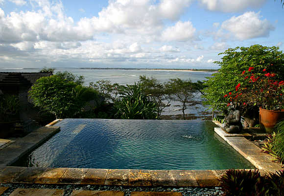A private pool looks out over Jimbaran Bay from a villa in Bali.