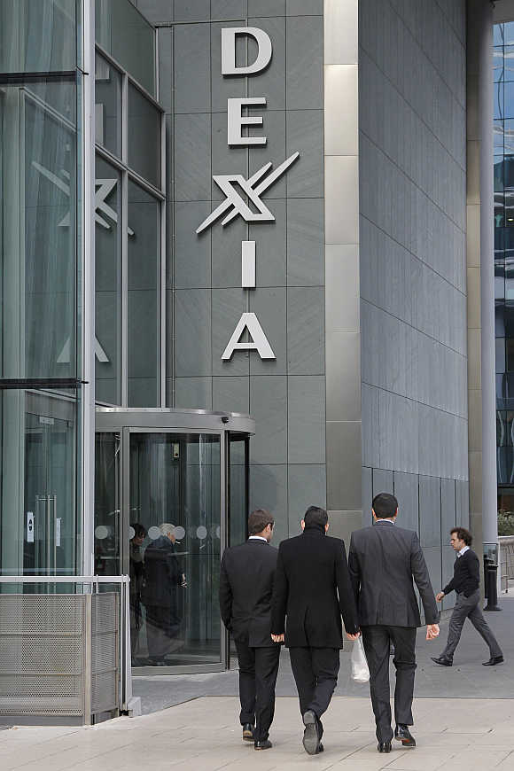 Businessmen walk outside the Dexia tower in La Defense, near Paris.