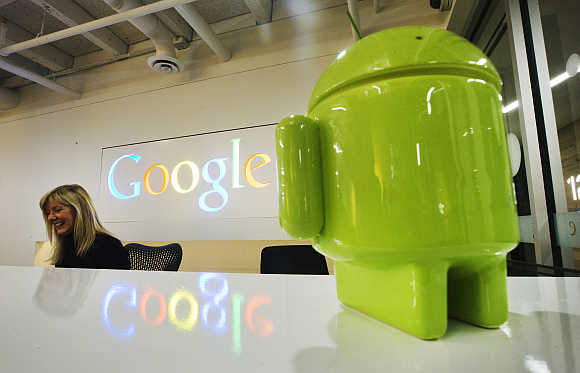 A Google Android figurine sits on the welcome desk at the Google office in Toronto, Canada.