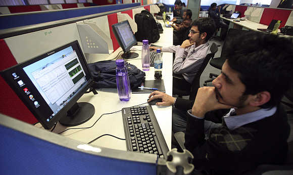 Employees of Snapdeal.com, an Indian online discount shopping website, work inside their company office in New Delhi.