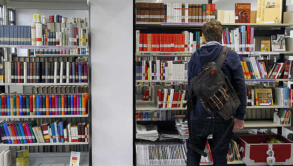 A man looks at books in Goethe Institute's library in Barcelona, Spain.
