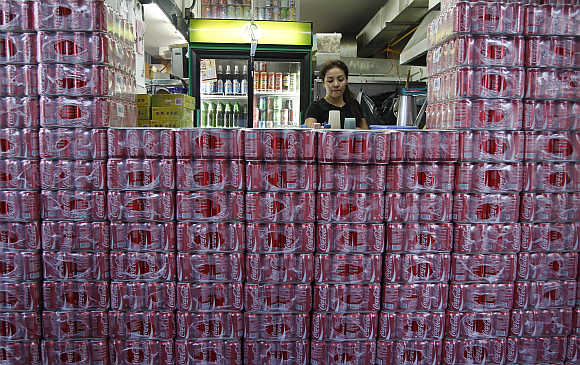 Crates of Coca-Cola are stacked outside a counter of a coffee shop in Singapore.
