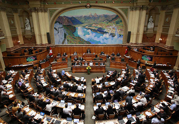 A view shows the members of the National Council during the parliament session in Bern, Switzerland.