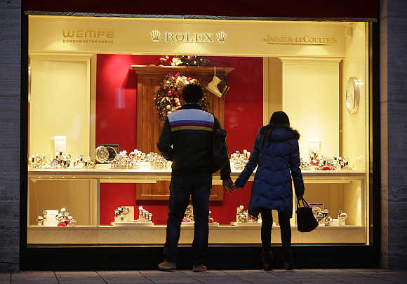 A couple looks into a shop window of a jeweller in Frankfurt, Germany.