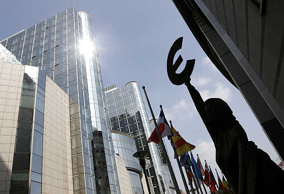 A statue depicting European unity is seen outside the European Parliament in Brussels, Belgium.