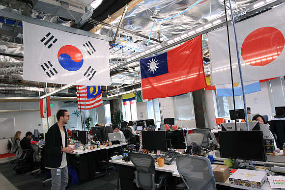 Employees work in the international user operations area at the headquarters of Facebook in Menlo Park, California.