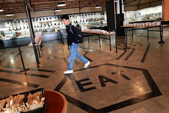 An employee walks through the cafeteria at the headquarters of Facebook in Menlo Park, California.
