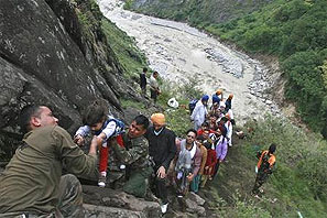 Soldiers rescue stranded tourists in Uttarakhand. Photograph: Reuters
