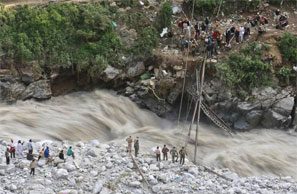 Soldiers try to repair a temporary footbridge over River Alaknanda after it was destroyed, during rescue operations in Govindghat in Uttarakhand June 22, 2013. Photograph: Danish Siddiqui/Reuters