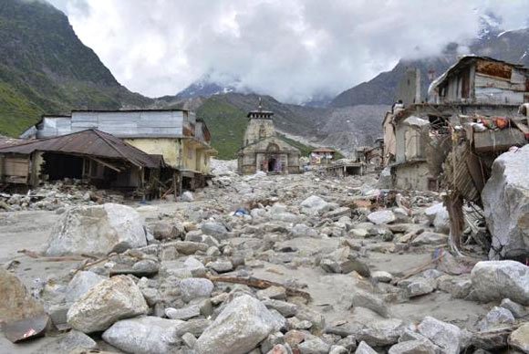 The Kedarnath Temple (C) is pictured amid damaged surroundings.