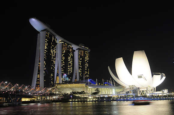 Marina Bay Sands hotel, left, and ArtScience Museum, right, in Singapore.