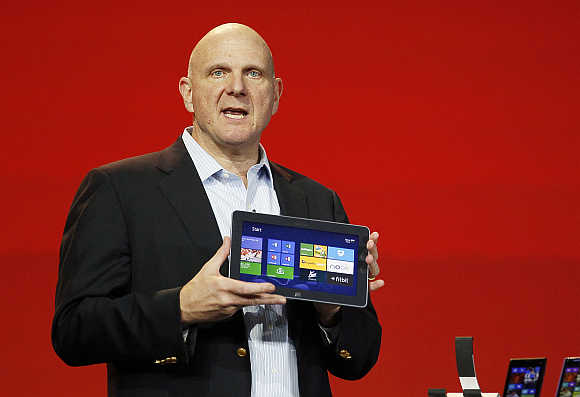 Microsoft CEO Steve Ballmer displays the Windows Surface tablet at the Qualcomm pre-show keynote at the Consumer Electronics Show in Las Vegas.