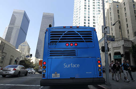 An advertisement for Microsoft's Surface tablet computer is pictured on a city bus in downtown Los Angeles, California.