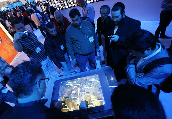 Visitors interact with Bing Maps at the Microsoft booth during the International Consumer Electronics Show in Las Vegas.