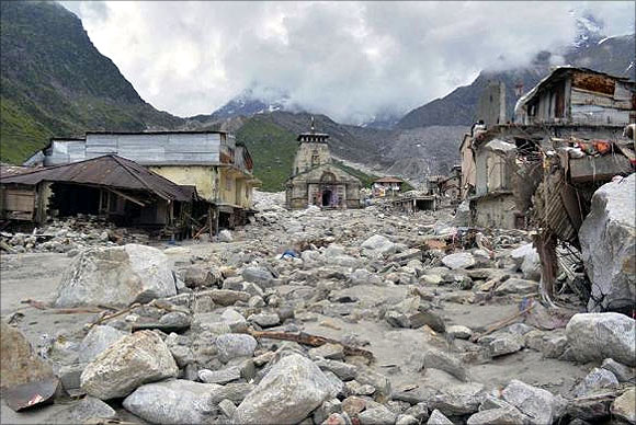 The Kedarnath Temple (C) is pictured amid damaged surroundings by flood waters at Rudraprayag in Uttarakhand.