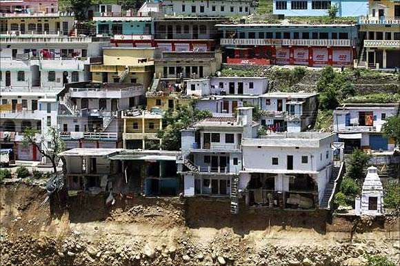 Damaged houses are seen at a village in Rudraprayag in Uttarakhand.