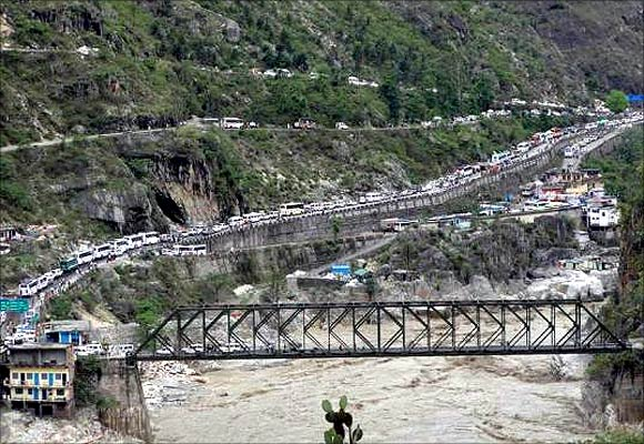Stranded vehicles stand in queues after heavy rains in Uttarakhand.