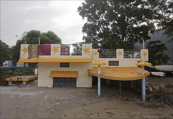 A house submerged in sand due to floods in Srinagar, in Uttarakhand.