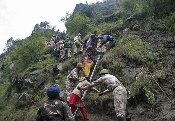 Soldiers rescue stranded people after heavy rains in Uttarakhand.