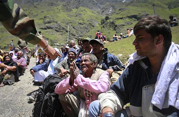 A survivor pleads with a soldier to allow him to board an army helicopter, during rescue operations at Badrinath.