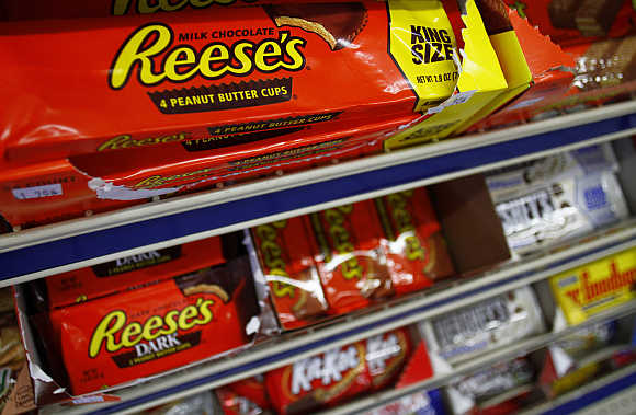 Packets of Reese's peanut butter cups are displayed at a gas station in Phoenix, Arizona, United States.